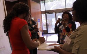 Wendy Ida signing copies of her books